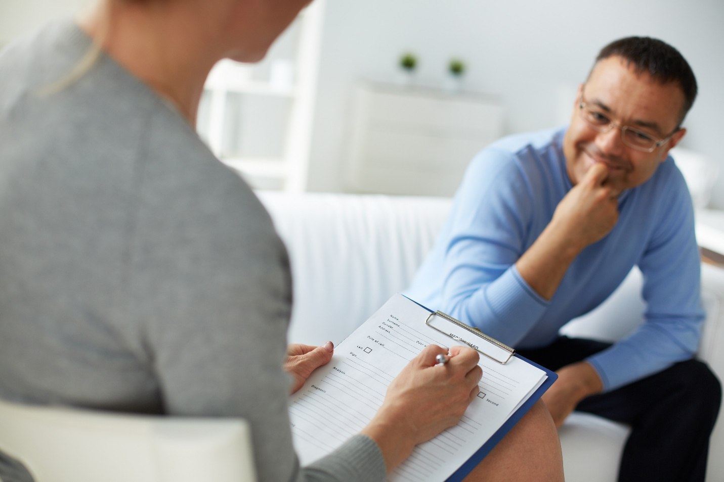 psychologist consulting man during psychological therapy session